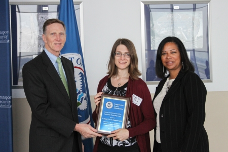 "NCTE Director of Policy Harper Jean Tobin accepts the Transportation Security Administraton's ""Community Partner"" award."